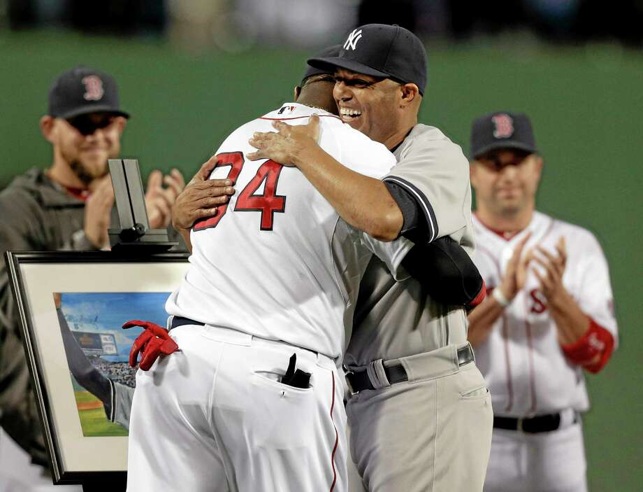 Yankees closer Mariano Rivera, right, hugs David Ortiz during a tribute before Sunday's game. Photo: Steven Senne — The Associated Press  / AP