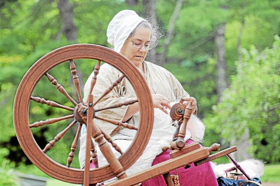 Terri Guerette giving a yarn spinning demonstration at Barkhamsted Days  on the town green in Barkhamsted on Saturday. Photo: Laurie Gaboardi - Register Citizen