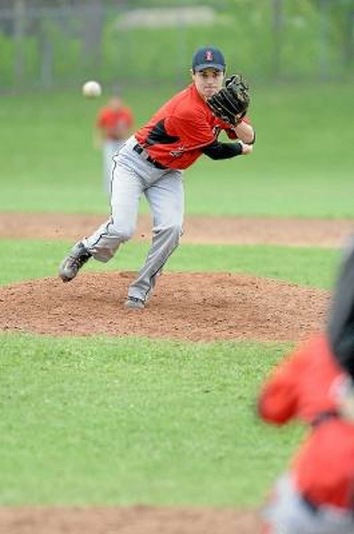 Laurie Gaboardi/Register Citizen Northwestern's Zach August pitches a complete game two-hitter.