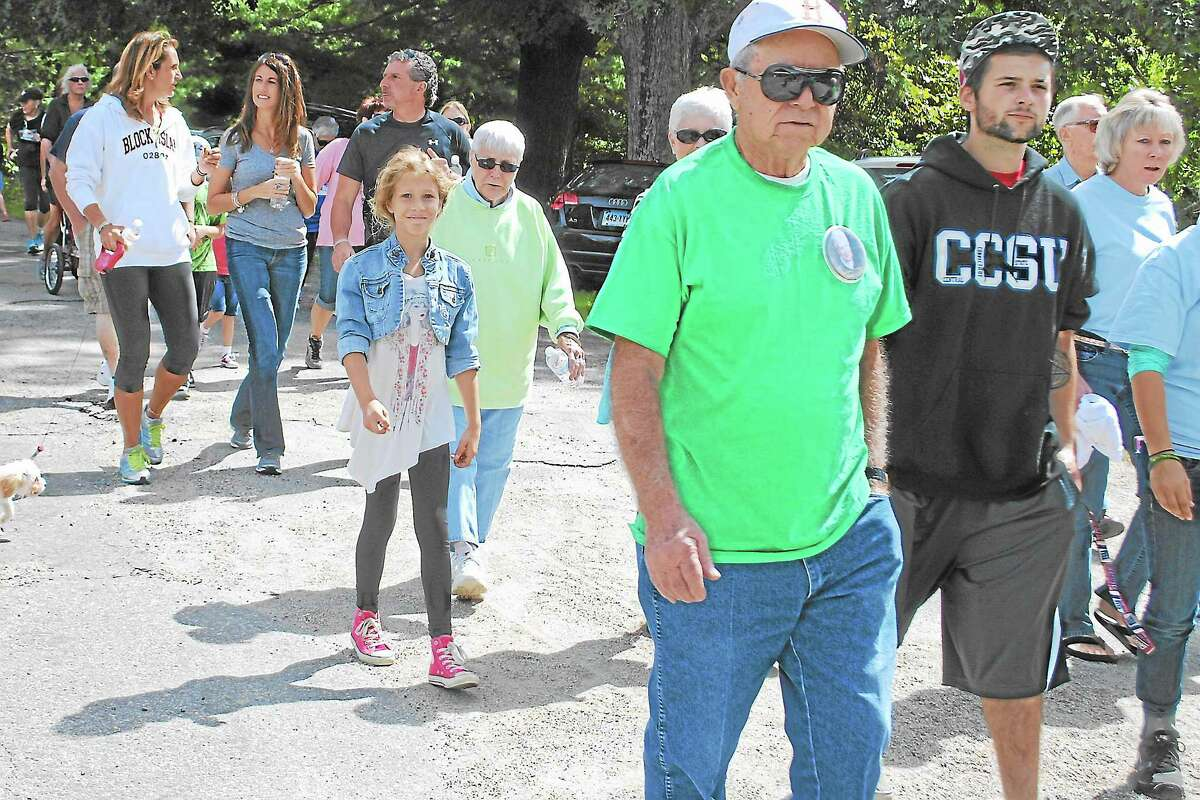 """People walk towards the one mile trail in the White Memorial Conservation, as part of the Torrington Area Parkinson's Support Group's """"Walk in the Woods."""""""