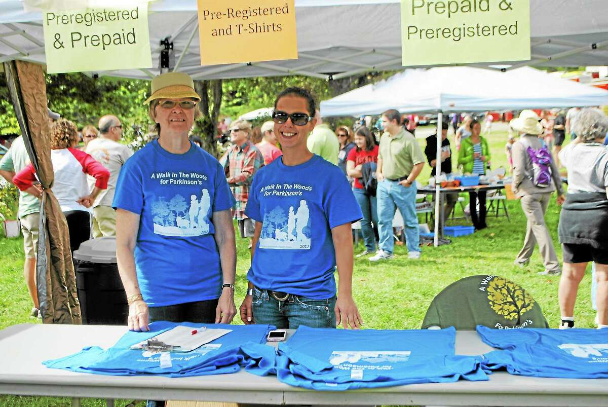 """Volunteers Carol Pathe, left, and Sabrina Zaffina work at the Torrington Area Parkinson's Support Group """"Walk in the Woods."""""""
