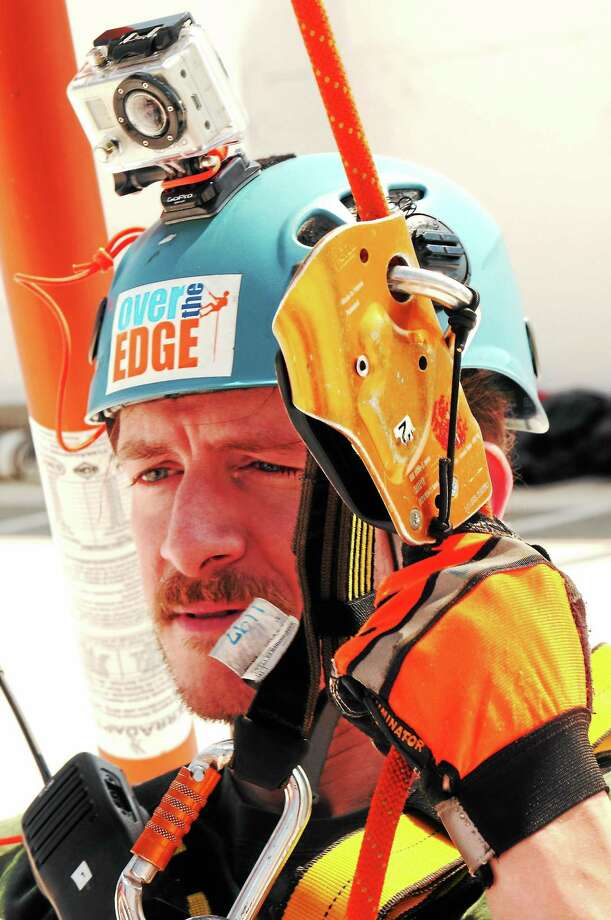 (Photo by Peter Hvizdak — Register)Connecticut Digital First Media reporter Jack Coraggio prepares to rappel down the 15-story building at 101 Park Place at Harbor Point in Stamford, Conn., Thursday, September 12, 2013 during a fundraising event for Connecticut Special Olympics organized by Over the Edge. Photo: New Haven Register / ©Peter Hvizdak /  New Haven Register