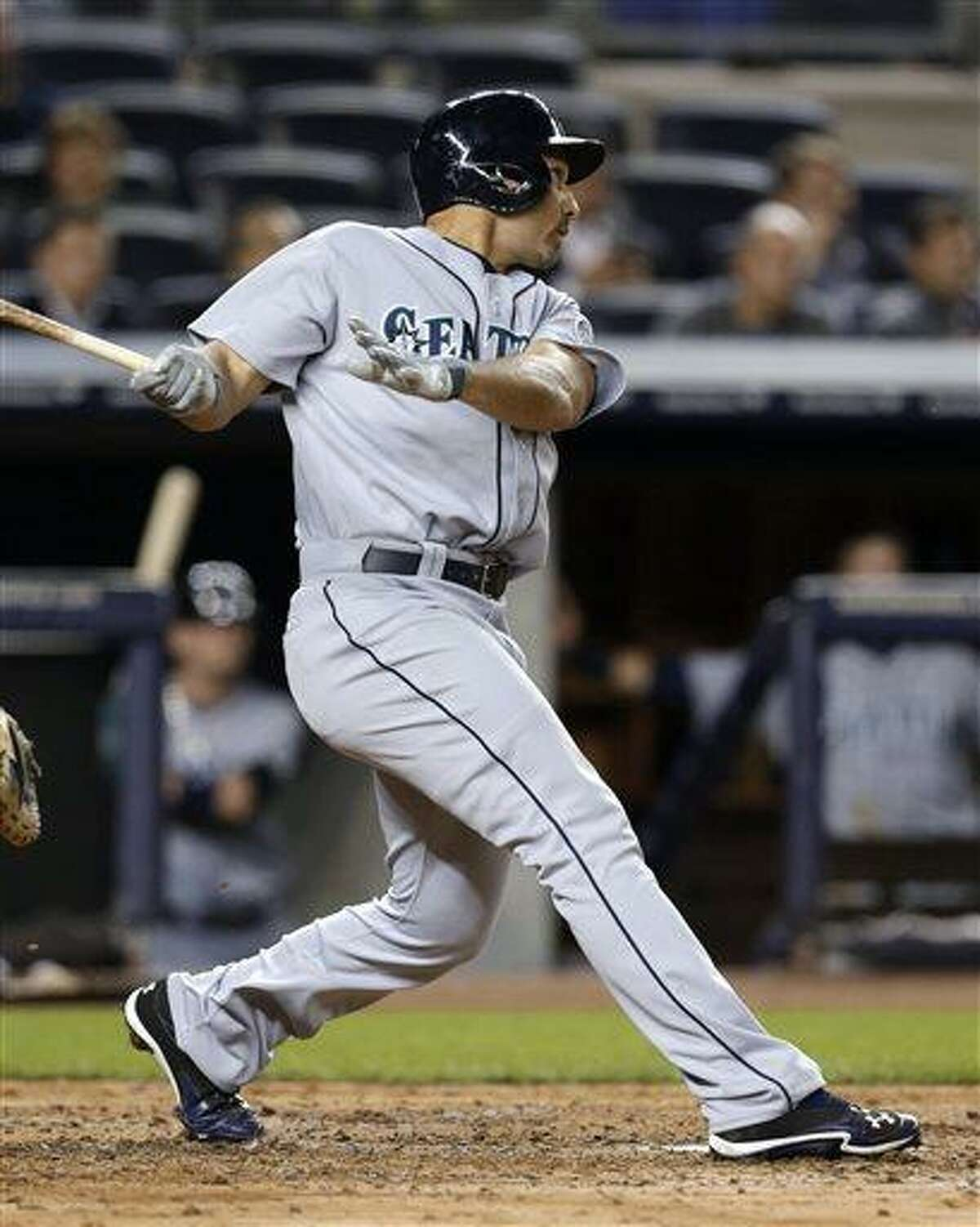 Seattle Mariners' Raul Ibanez watches his two-run home run off New York Yankees pitcher Brett Marshall during the fifth inning of a baseball game at Yankee Stadium in New York, Wednesday, May 15, 2013. (AP Photo/Julio Cortez)