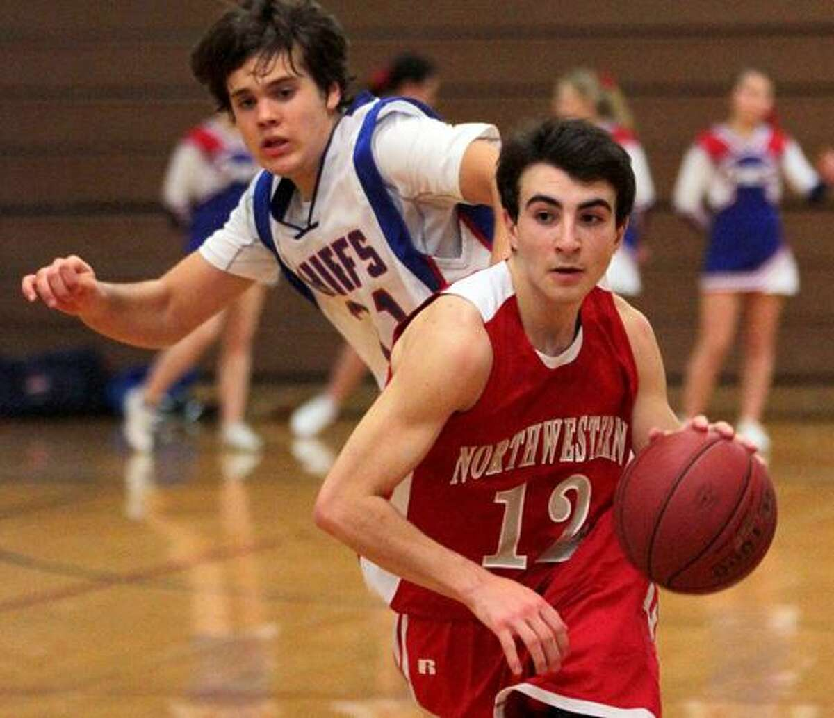 Marianne Killackey/Special to the Register Citizen Northwestern's Arthur Lefevre (12) dribbles down the court in his team's win over the Chiefs