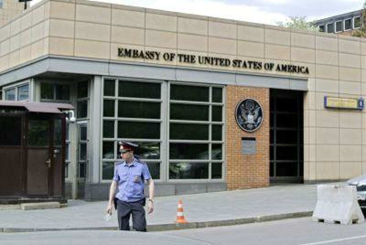 A Russian policeman stands in front of an entrance of the U.S. Embassy in the background in downtown Moscow May 14.