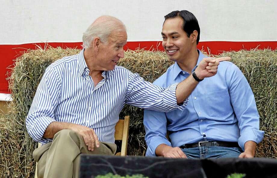 Vice President Joe Biden talks with San Antonio Texas Mayor Julian Castro, right, during Iowa Sen. Tom Harkin's annual fundraising steak fry dinner, Sunday, Sept. 15, 2013, in Indianola, Iowa. (AP Photo/Charlie Neibergall) Photo: AP / AP