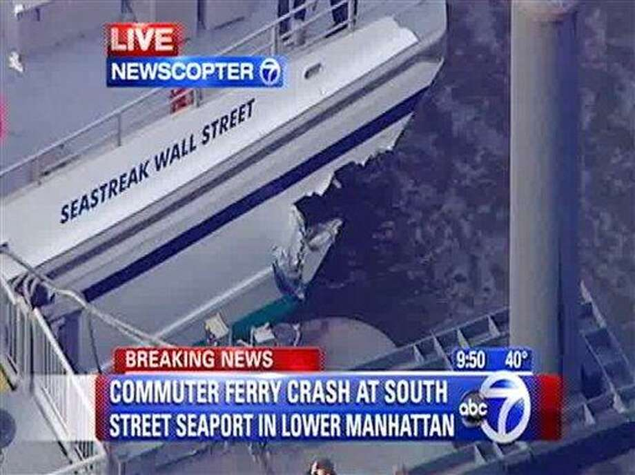 This frame grab taken from WABC News Channel 7 aerial video shows damage to a commuter ferry Wednesday in Lower Manhattan in New York. (AP Photo/WABC News Channel 7) Photo: AP / WABC 7