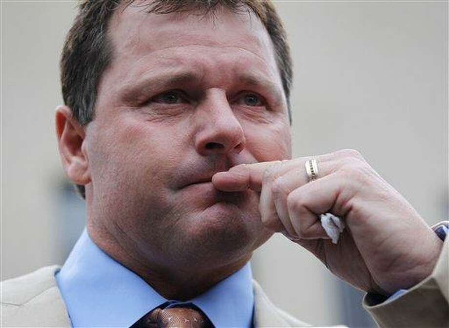 FILE - This June 18, 2012 file photo shows former Major League Baseball pitcher Roger Clemens pausing as he speaks to the media outside federal court in Washington. With the cloud of steroids shrouding many candidacies, baseball writers may fail for the only the second time in more than four decades to elect anyone to the Hall. (AP Photo/Pablo Martinez Monsivais, File) Photo: ASSOCIATED PRESS / The Associated Press2012