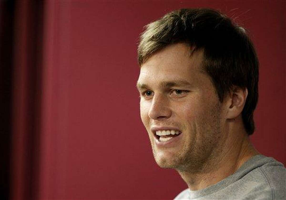 New England Patriots quarterback Tom Brady answers a reporter's question during a media availability at the NFL football team's facility in Foxborough, Mass., Wednesday, Jan. 9, 2013. (AP Photo/Stephan Savoia)