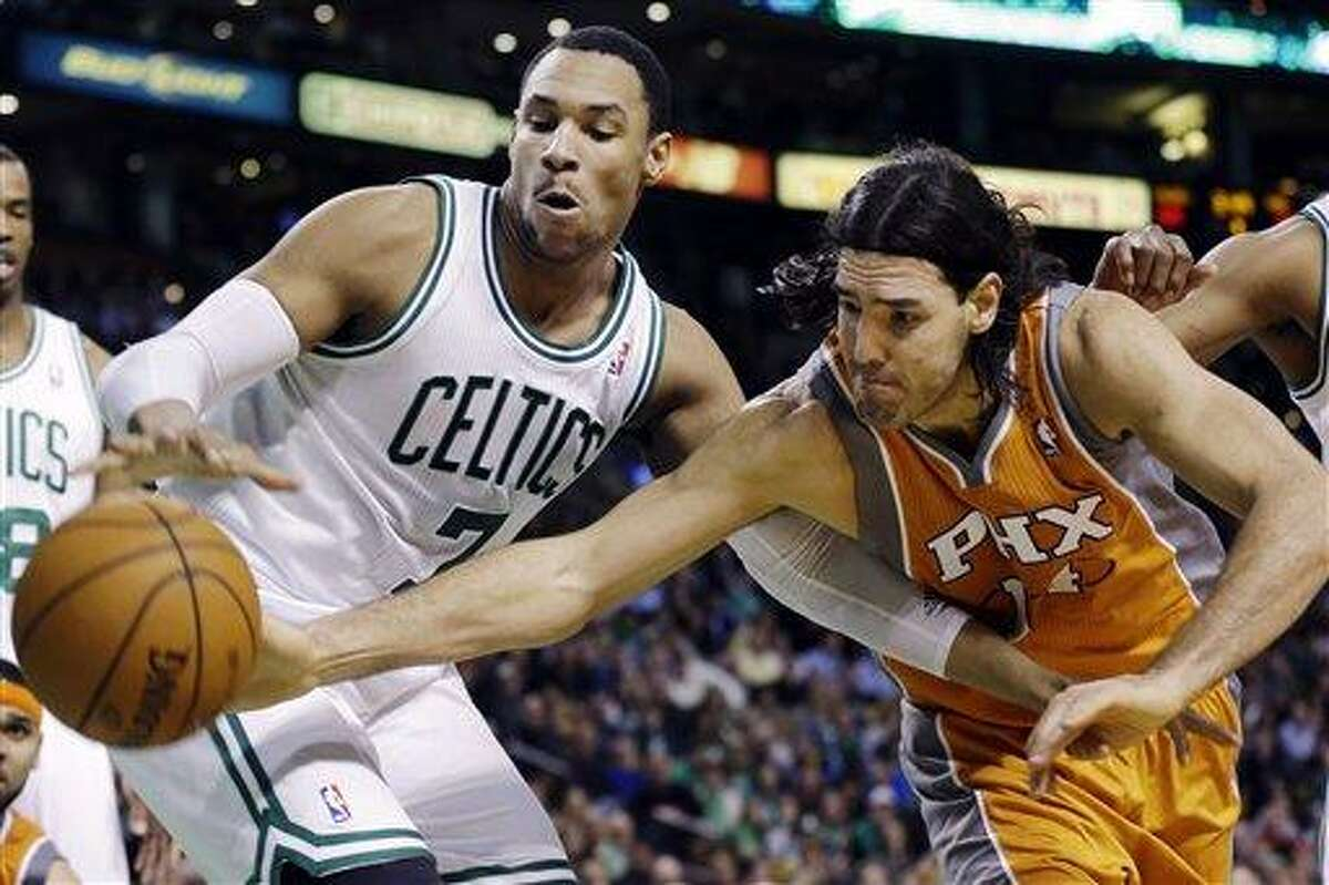 Boston Celtics forward Jared Sullinger (7) fights for control of a rebound with Phoenix Suns forward Luis Scola, right, during the second half of an NBA basketball game in Boston, Wednesday, Jan. 9, 2013. The Celtics won 87-79. (AP Photo/Elise Amendola)