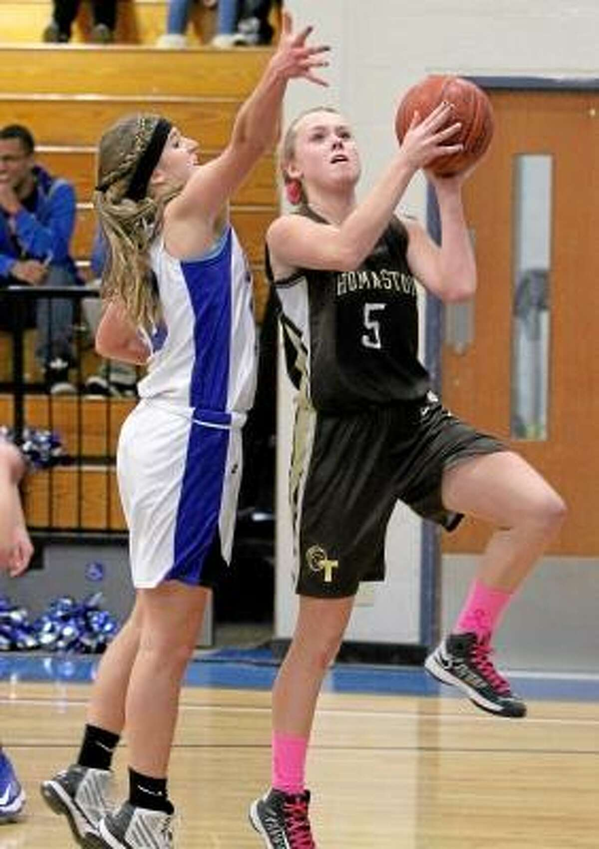 Abby Hurlbert (5) of Thomaston goes up for a shot as Lewis Mills' Lesleigh Carter (10) attempts to block. Photo by Marianne Killackey/Special to Register Citizen