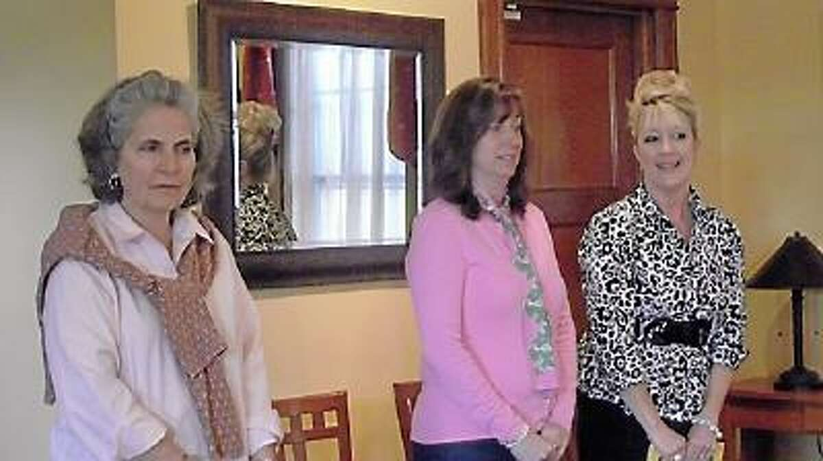 Charlene Goodman Dutka, Darcy Manchak of Ciesco Catering and Karen Thomas, etiquette coach at a tea party held today for one of Miss Stacey's Early Childhood Education Center's 4-year-old classes. (Jenny Golfin)