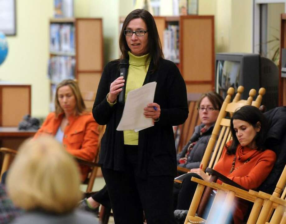 Reed Intermediate School, Newtown, Board of Education meeting. Michele Hankin was the second parent to ask the board and Superintendent Janet Robinson (back of head, left) to keep the extra police presence at the schools.  Mara Lavitt/New Haven Register1/8/13
