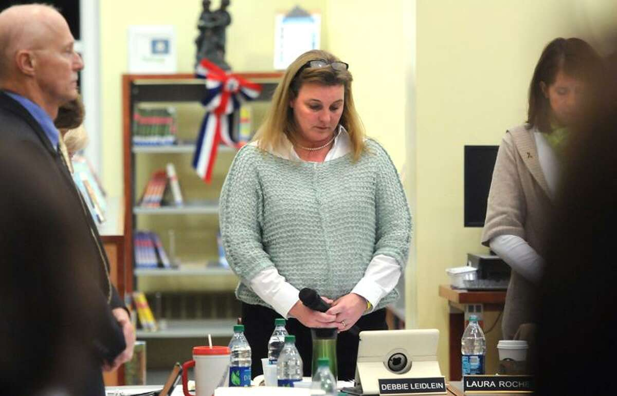 Reed Intermediate School, Newtown, Board of Education meeting. Newtown Board of Education chairwoman Debbie Leidlein bows her head for the moment of silence she called. Mara Lavitt/New Haven Register1/8/13