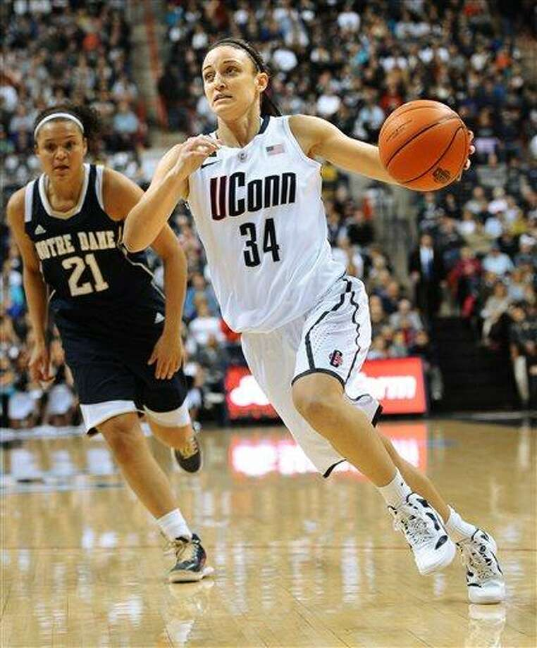 Connecticut's Kelly Faris (34) is pursued by Notre Dame's Kayla McBride during the first half of an NCAA college basketball game in Storrs, Conn., Saturday, Jan. 5, 2013. (AP Photo/Jessica Hill) Photo: ASSOCIATED PRESS / A2013