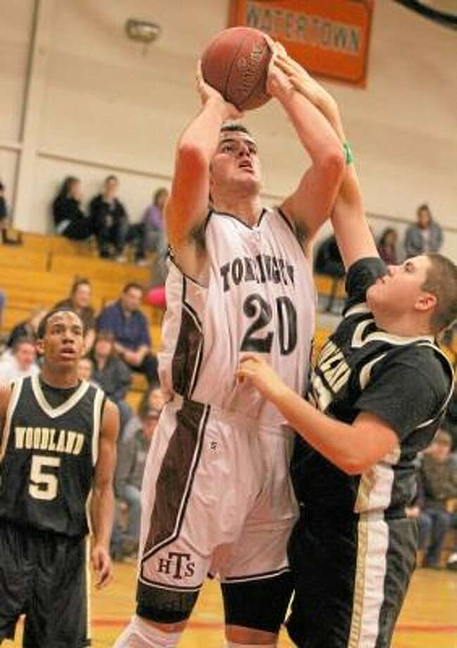 Matthew Spofford of Woodland (50, right) tries unsuccessfully to block Dave Canny's (20) shot in Torrington's win over Woodland Tuesday night. Photo by Marianne Killackey/Special to Register Citizen / 2012