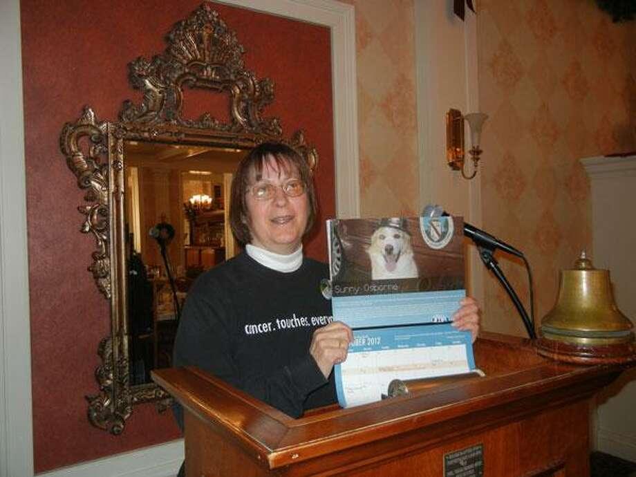 Alice Tessier/Register Citizen  Torrington Rotary's guest speaker, Dawn Osborne, a volunteer for 2 Million Dogs 2 Miles Foundation.