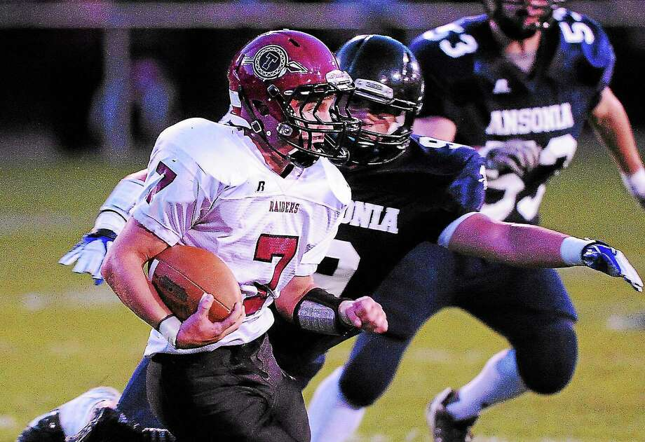 Torrington's Tyler Marens gets some extra yards during the second quarter. Photo: Peter Casolino — New Haven Register