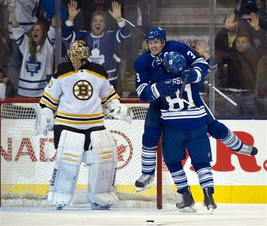Toronto Maple Leafs defenceman Dion Phaneuf celebrates with teammate Phil Kessel (81) after scoring on Boston Bruins goalie Tuuka Rask during third period first round NHL playoff action in Toronto on Sunday May 12, 2013. (AP Photo/The Canadian Press, Frank Gunn) Photo: AP / CP