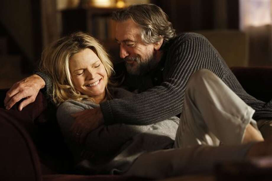 "This film publicity image released by Relativity Media shows Michelle Pfeiffer, left, and Robert DeNiro in ""The Family."" (AP Photo/Relativity Media) Photo: AP / Relativity Media"