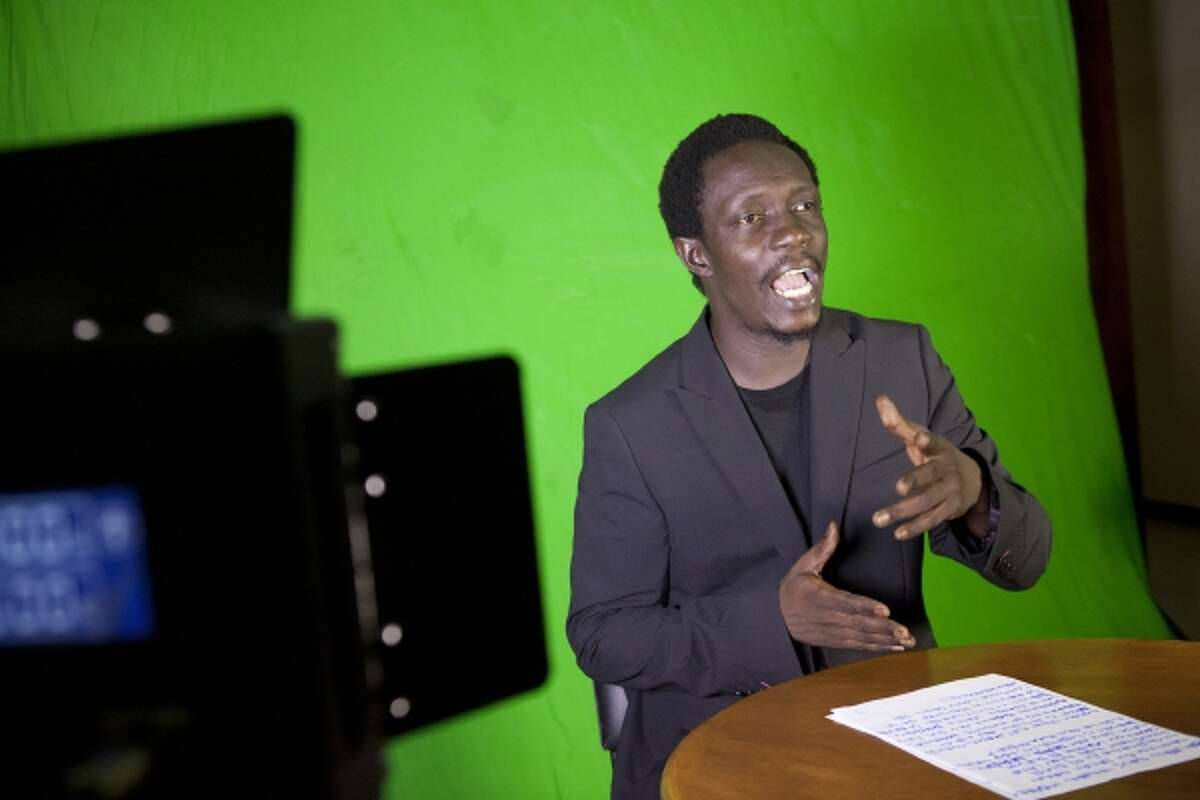 In this photo taken Tuesday, Sept. 10, 2013, rapper Cheikh 'Keyti' Sene lays down verse about the week's news during a taping of the 'Journal Rappe,' in Dakar, Senegal. In the span of a program just five minutes long, Sene and his co-host Makhtar 'Xuman' Fall tackle, in rhyming verse, everything from the Middle East to local woes like the flooding that disproportionately hits poor suburbs of Senegal's capital. The news and commentary show, rapped in French and Wolof, went viral on YouTube earlier this year and now airs twice a week on Senegalese television. (AP Photo/Jane Hahn)
