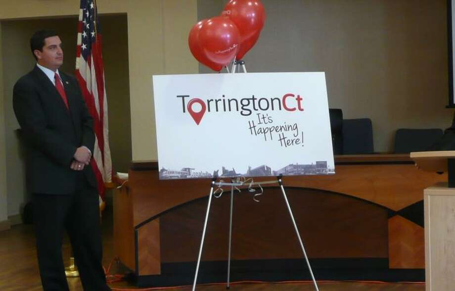 """Kate Hartman/Register Citizen -- Mayor Ryan Bingham announced the new slogan for Torrington, """"It's Happening Here!"""" at a press conference Monday morning."""
