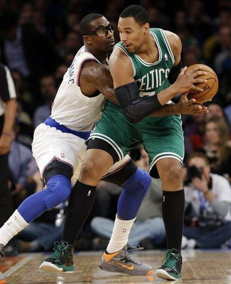 New York Knicks forward Amare Stoudemire (1) defends against Boston Celtics forward Jared Sullinger (7) in the first half of their NBA basketball game at Madison Square Garden in New York, Monday, Jan. 7, 2013. (AP Photo/Kathy Willens) Photo: ASSOCIATED PRESS / AP2013