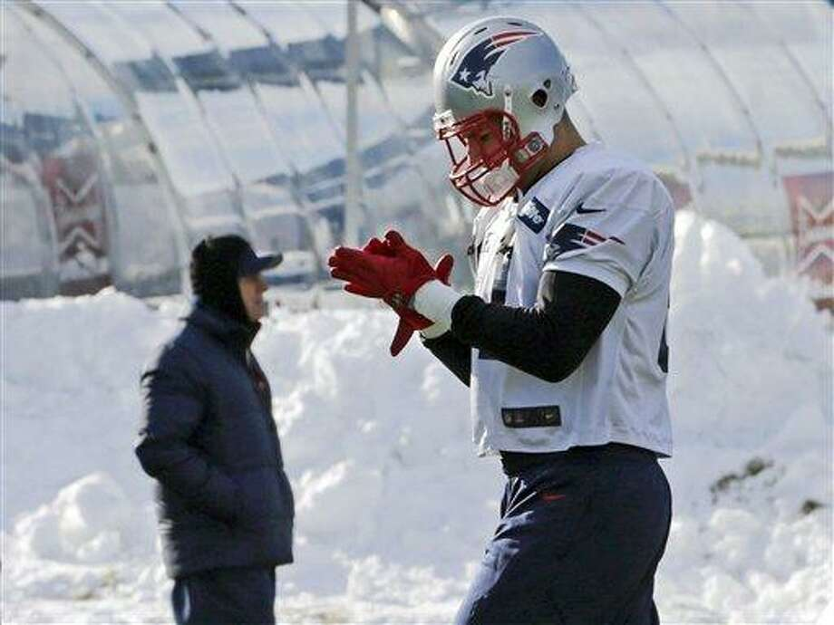 New England Patriots wide receiver Aaron Hernandez gets ready to run a drill during NFL football practice in Foxborough, Mass., Wednesday, Jan. 2, 2013. The Patriots don't know who they'll face in their playoff opener. But, they do know plenty about that team. They are familiar with all three potential opponents, the Texans, Ravens and Colts, having played them already this season. (AP Photo/Charles Krupa) Photo: ASSOCIATED PRESS / AP2013