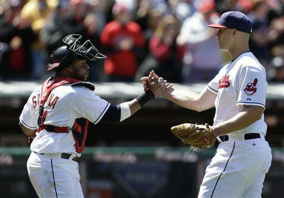 Cleveland Indians starting pitcher Justin Masterson, right, is congratulated by catcher Carlos Santana after the Indians defeated the New York Yankees 1-0 in the first baseball game of a doubleheader, Monday, May 13, 2013, in Cleveland. (AP Photo/Tony Dejak)