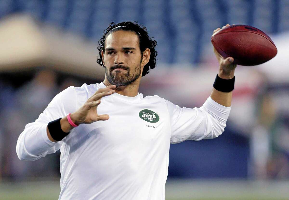 Jets quarterback Mark Sanchez, who normally throws right-handed, throws a pass lefty before New York's game against the New England Patriots Thursday in Foxborough, Mass.