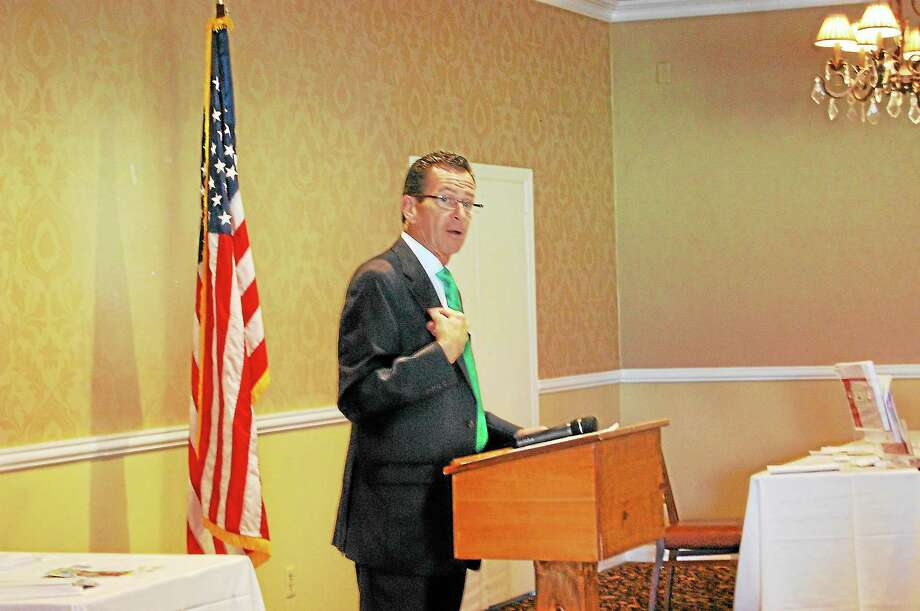 Gov. Dannel Malloy speaks at the Northwest Connecticut Chamber of Commerce's 2013 Manufacturing Summit at P. Sam's Bar and Grill in Torrington Friday. Photo: Jenny Golfin—Register Citizen