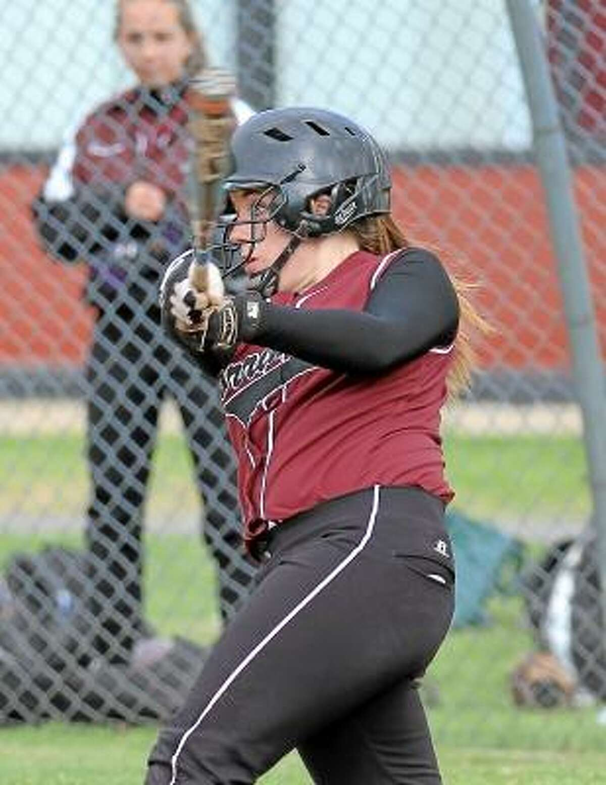 Marianne Killackey/Special to Register Citizen Torrington's Marissa Morris watches the ball after connecting for a single in her team's victory over Sacred Heart.
