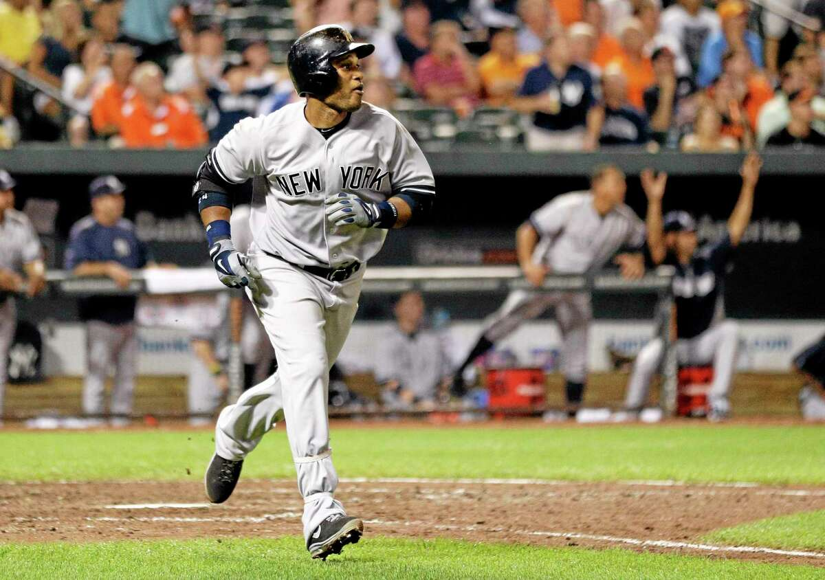 The Yankees' Robinson Cano jogs toward first as he watches his solo home run in the ninth inning that helped lift the Yankees to a 5-4 victory.