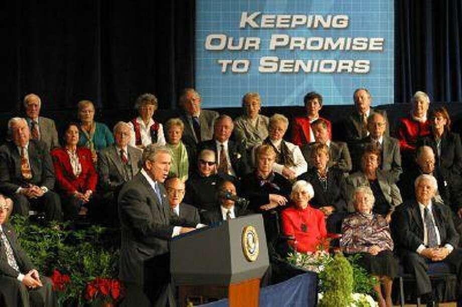 President George W. Bush speaks in December 2003 before signing the Medicare Modernization Act, which created Medicare Part D.