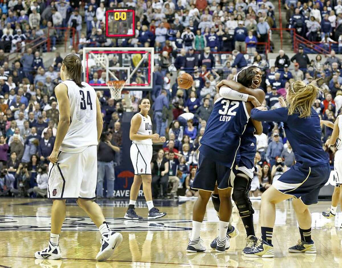 Jan 5, 2013; Storrs, CT, USA; The Notre Dame Fighting Irish celebrate after defeating the Connecticut Huskies at Gampel Pavilion. Mandatory Credit: Mark L. Baer-USA TODAY Sports