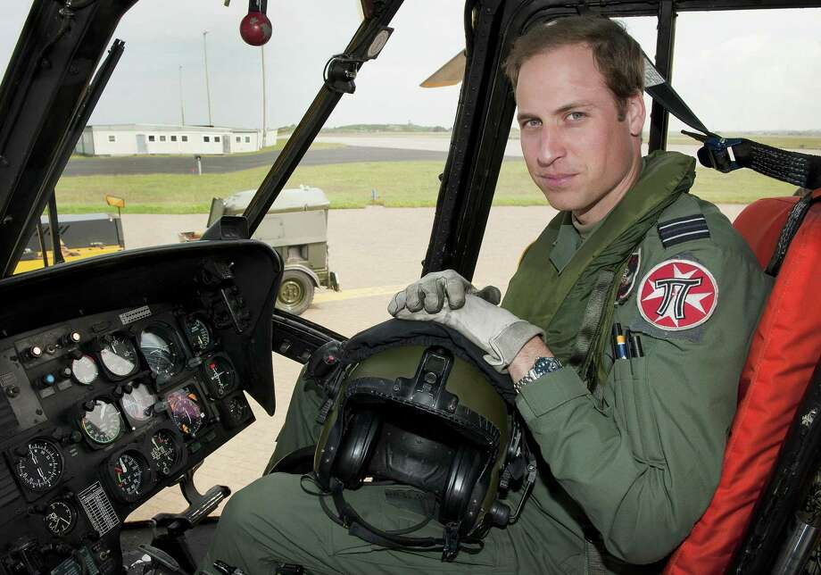 FILE - In this Friday, June 1, 2012  file photo released by Britain's Ministry of Defence , Britain's Prince William sits in the cockpit of a helicopter at RAF Valley in Anglesey Wales. Prince William has finished his tour of duty as a Royal Air Force search-and-rescue helicopter pilot and has left operational service with the British military to focus on royal duties and charity work, royal officials said Thursday, Sept 12, 2013.  William's Kensington Palace office said that the second in line to the British throne completed his final shift earlier this week.  (AP Photo/ SAC Faye Storer, MOD, File) Photo: AP / MOD