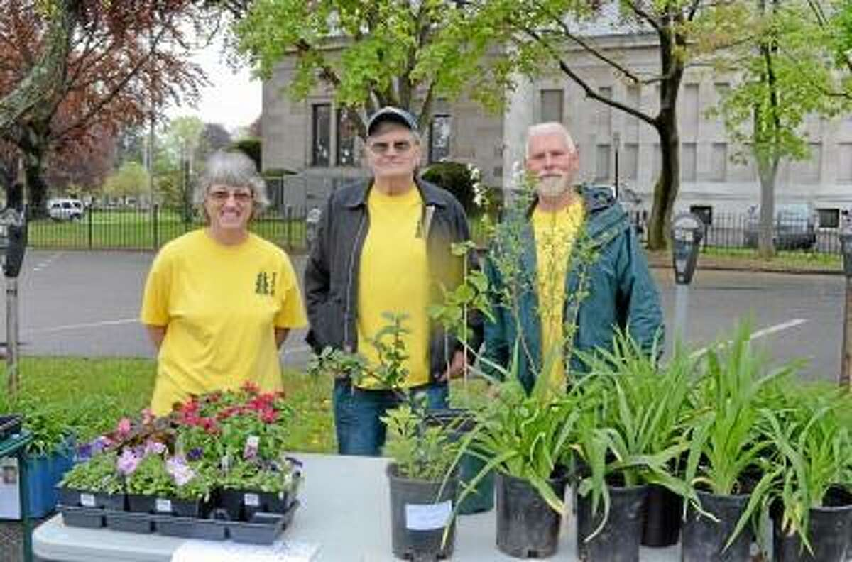 Kate Hartman/Register Citizen. Barb Morris, Tom Ross and John Bekasi, members of the Torrington Trails Network, sold plants for Mother's Day as a fundraiser for their organization.