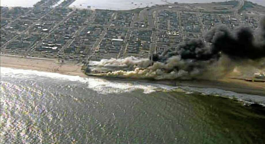 This frame grab from video provided by Fox 29 shows a raging fire in Seaside Park, N.J. on Thursday, Sept. 12, 2013.  The fire apparently started in an ice cream shop and spread several blocks down  the New Jersey shore boardwalk that was damaged in Superstorm Sandy (AP Photo/Fox 29) MANDATORY CREDIT Photo: AP / Fox 29