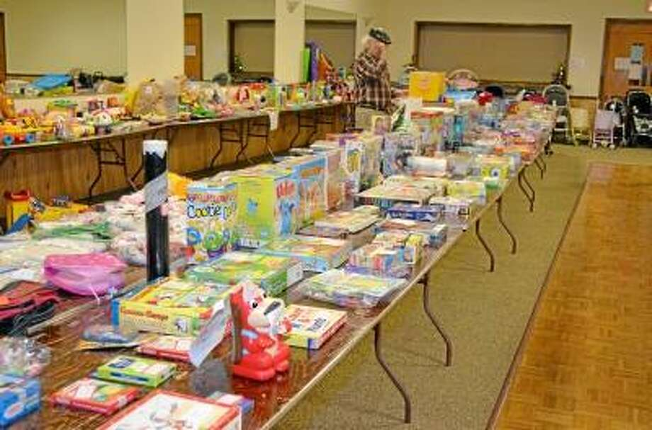 Kate Hartman/Register Citizen. Clothing, toys, strollers and books were some of the items available at the Tots Treasures Consignment Sale hosted at the Knights of Columbus.