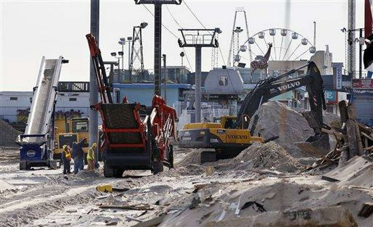 Crews work Thursday on the boardwalk in Seaside Heights, N.J. Under intense pressure from angry Republicans, House Speaker John Boehner has agreed to a vote Friday on aid for Superstorm Sandy recovery. Associated Press