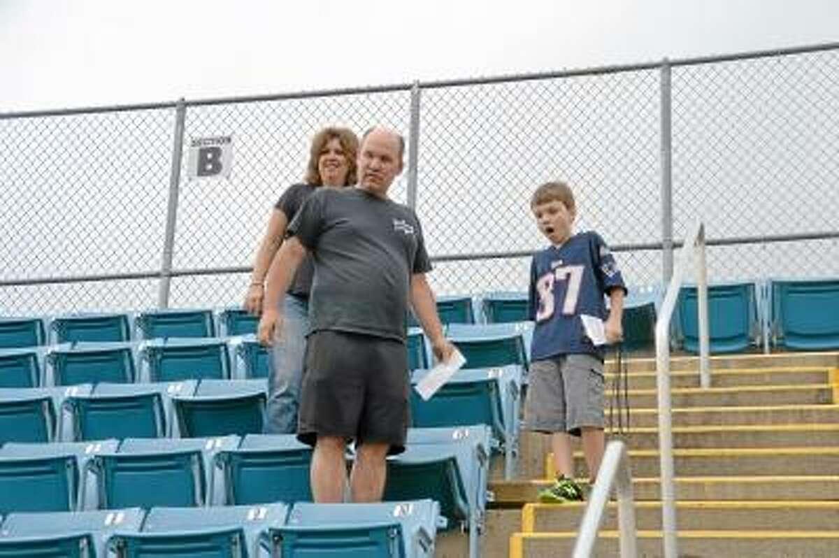 Pete Paguaga/Register Citizen The Karpeichik family, of Chris (center), Barbara (back) and Jason (right) pick their seats for the entire season.