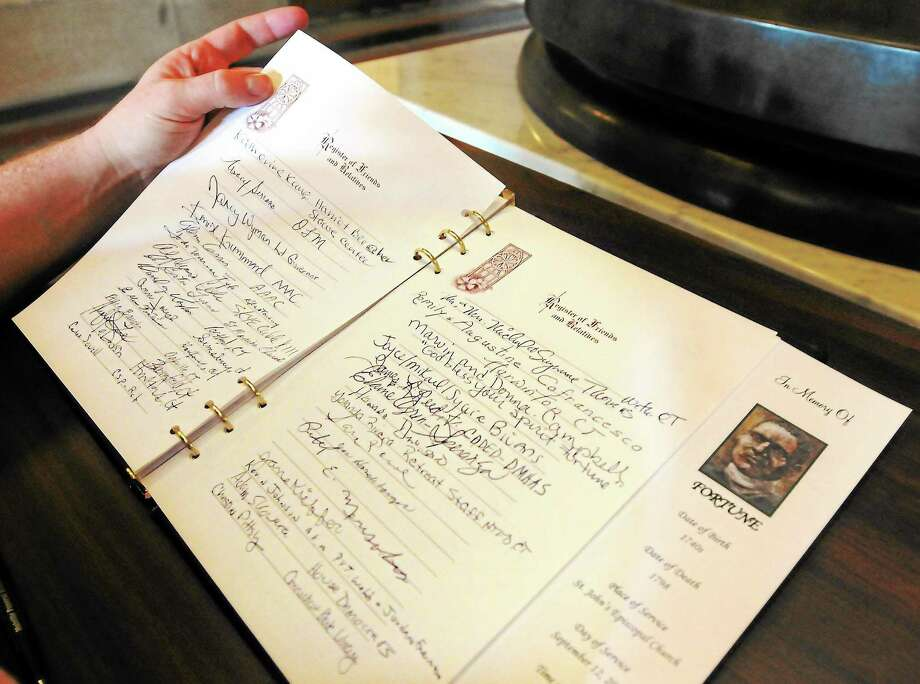 (Mara Lavitt — New Haven Register) September 12, 2013 Hartford.The bones of the slave known as Fortune, who lived in Waterbury in the 18th century, lay in state in the State Capitol, Hartford, before his burial in Waterbury. Visitors could sign a guest book near the casket. Photo: Journal Register Co. / Mara Lavitt