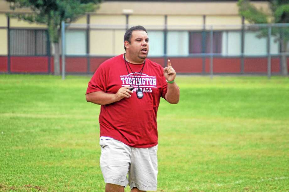 Gaitan Rodriguez goes over drills during practice. Rodriguez a '97 graduate of Torrington High School enters his first season as the Red Raiders head coach. Photo: Pete Paguaga — Register Citizen
