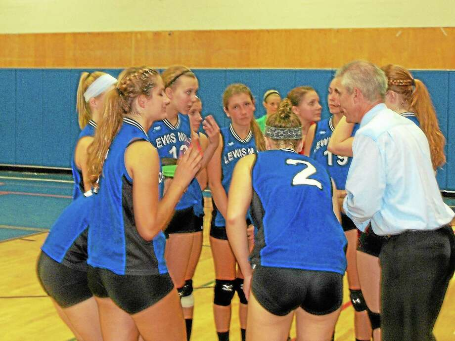 Coach Chuck Drda talks strategy with the Spartans in Lewis Mills' 3-2 volleyball win over Southington Wednesday night. Photo: Peter Wallace — Register Citizen