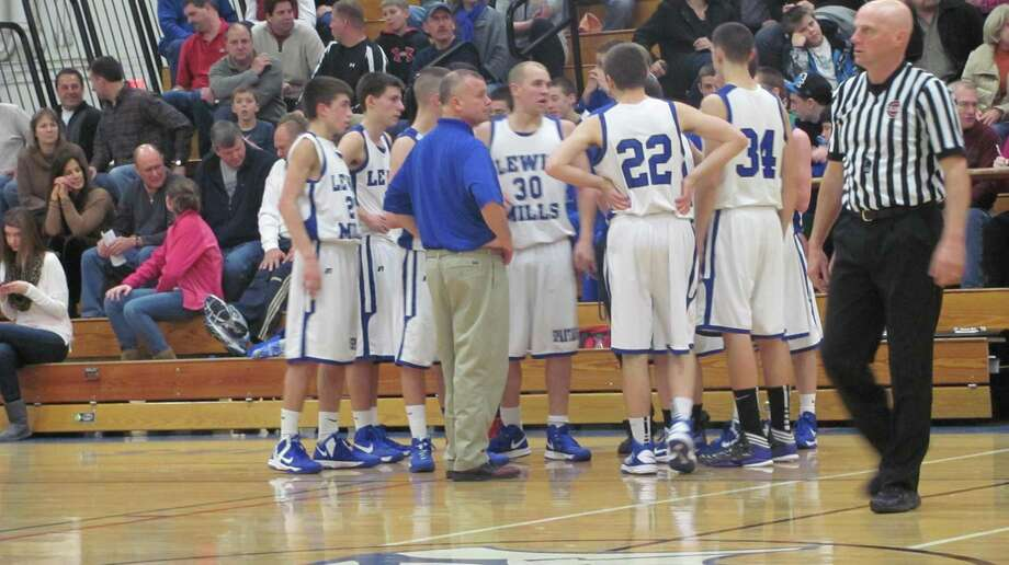 Lewis Mills coach Todd Kozak stands with his team. Photo by John Nestor/Register Citizen Correspondent