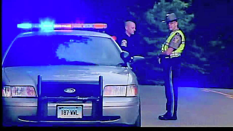 State police outside a Cornwall Bridge Road home in Sharon after a home invasion homicide Aug. 6, 2012. Photo: WTNH News 8 Photo