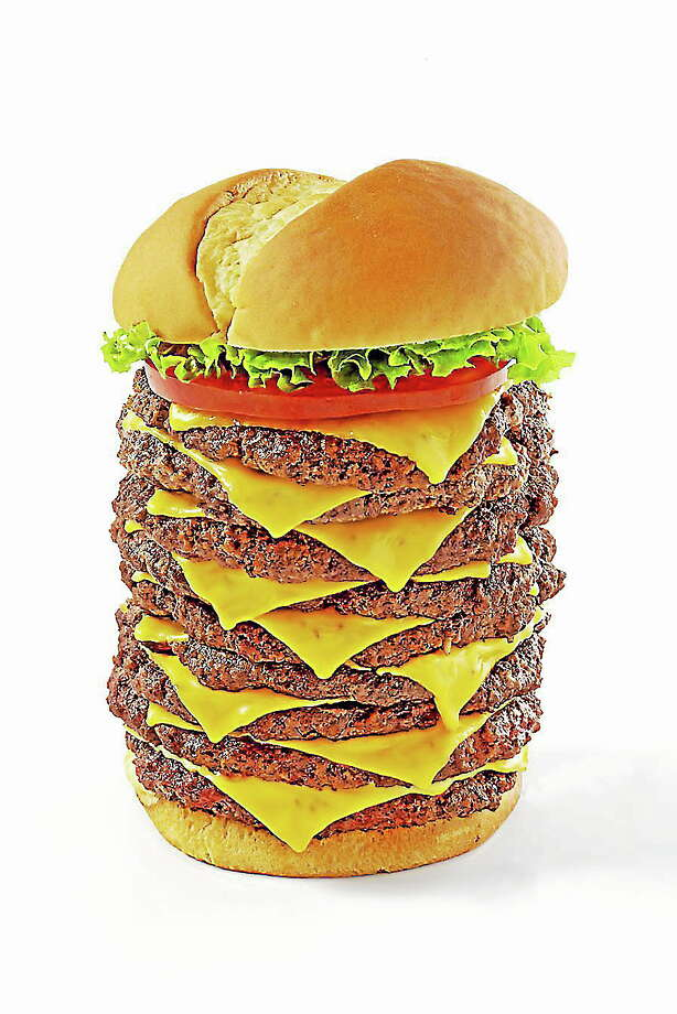 The Triple Triple Burger. Photo: Contributed Photo