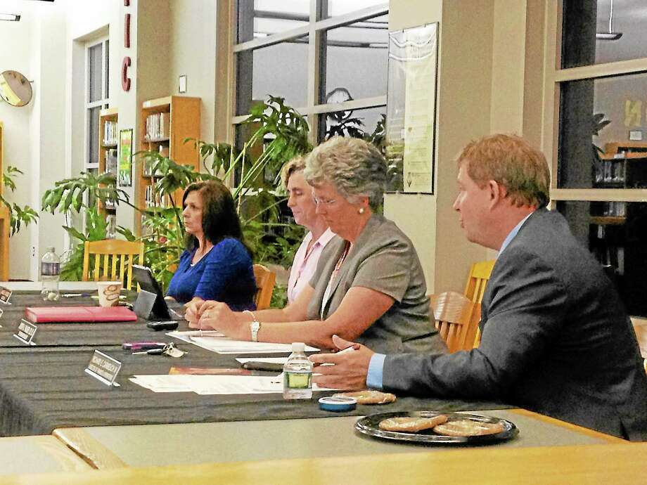 Richard Carmelich, director of financial operations explains Winchester's debt to Shared Services, pictured with Superintendent Judith Palmer, chair of the Board of Education, Molly Sexton Read and co-chair Janice Dorazio. Photo: Mercy Quaye—Register Citizen