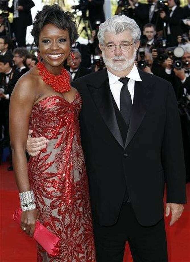 """In this May 14, 2010 photo, Filmmaker George Lucas, right, and Mellody Hobson arrive for the screening of """"Wall Street Money Never Sleeps"""", at the 63rd international film festival, in Cannes, southern France. A spokeswoman for Lucasfilm said on Thursday, Jan. 3, 2013, the 68-year-old director is engaged to 43-year-old investment firm president Mellody Hobson. (AP Photo/Matt Sayles, File) Photo: AP / AP"""