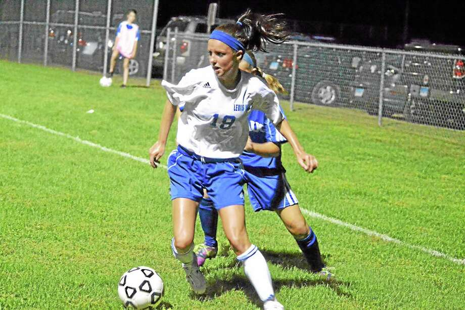 Anna Marinelli looks for an open teammate during Lewis Mills 7-0 win against Shepaug on Tuesday. Photo: Pete Paguaga—Register Citizen